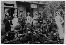 Convalescing soldiers and staff outside the Red Cross Voluntary Aid Detachment Hospital, Wellingtonia, 113 Mundesley Road, North Walsham during WW1