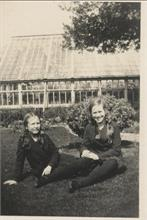 Elizabeth and Barbara Blewitt in front of greenhouse at Aylsham House, North Walsham.