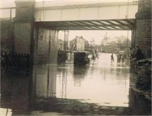 Flood under Midland and Great Northern Joint Railway line bridge, Norwich Road.