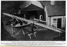 Members of the North Walsham Gliding Club constructing a glider somewhere in North Walsham