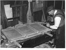 Mr L.W.Roper, Craftsman, at work on the World War Two Memorial