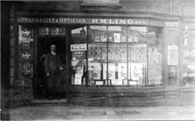 R M Ling(1) at 13 Market Place, North Walsham. The name above the door is now part of the protected frontage.