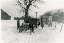 Tractor and Eastern Countries bus in snow at Hall Farm, Paston.