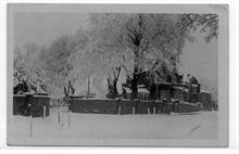 Tudor House, 8 Grammar School Road, North Walsham, in snow ( then home of John Dixon, organist, auctioneer, etc). Paston School gates on the left.