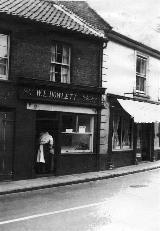 Photograph. Billy Howlett's fish shop on Market Street. (North Walsham Archive).