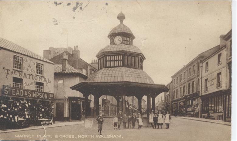 Photograph. Chidren by Market Cross, North Walsham. (North Walsham Archive).