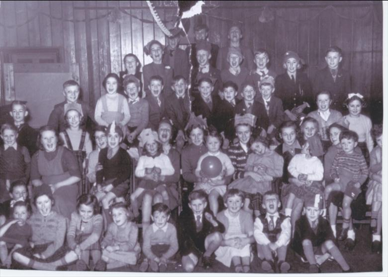 Photograph. Christmas Party for railway workers children. (North Walsham Archive).