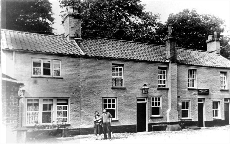 Photograph. The Cock Inn, North Street, North Walsham. (Now the Cockerel Restaurant) (North Walsham Archive).