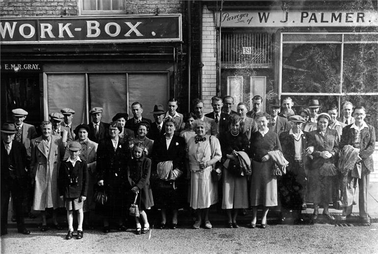 Photograph. Crowd waiting outside the Workbox. (North Walsham Archive).