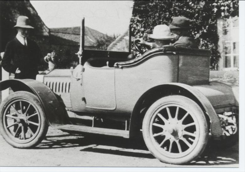 Photograph. Dr W.F.Blewitt driving his car. (North Walsham Archive).