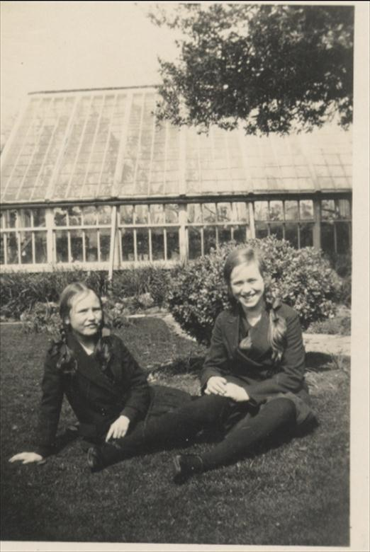 Photograph. Elizabeth and Barbara Blewitt in front of greenhouse at Aylsham House, North Walsham. (North Walsham Archive).