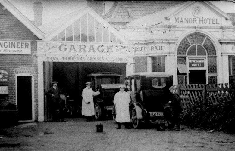 Photograph. Frank Mann's Garage at Mundesley, next to the Manor Hotel. (North Walsham Archive).
