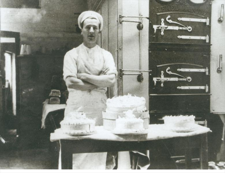 Photograph. Freddie Edwards in the Norwich Road Bakery (North Walsham Archive).
