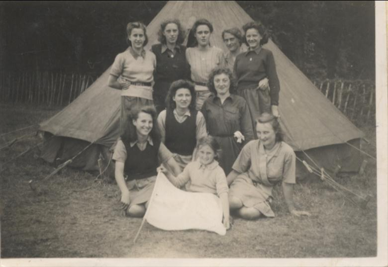 Photograph. Girl Guide Company North Walsham at camp in 1947 (North Walsham Archive).