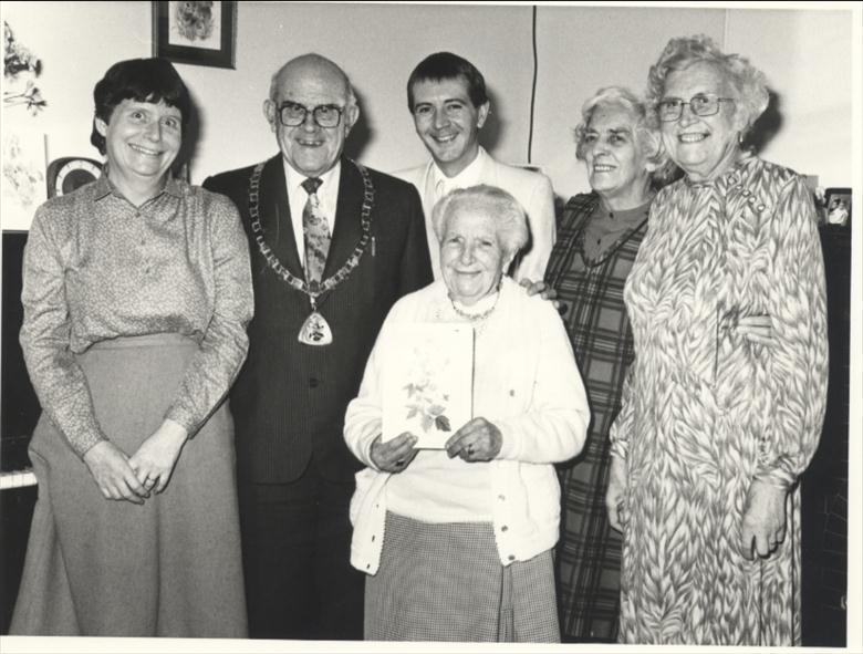 Photograph. Good Companions Club celebrate the 100th birthday of one of its members (North Walsham Archive).