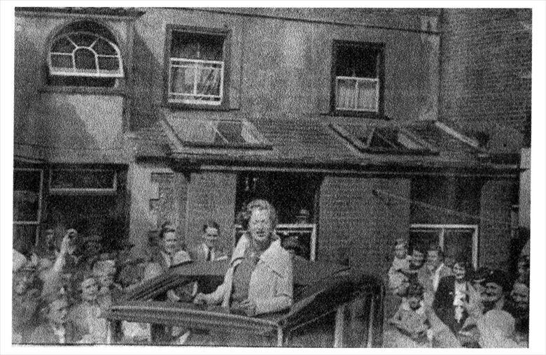 Photograph. Gracie Fields in the yard behind the Kings Arms Hotel, North Walsham. (North Walsham Archive).