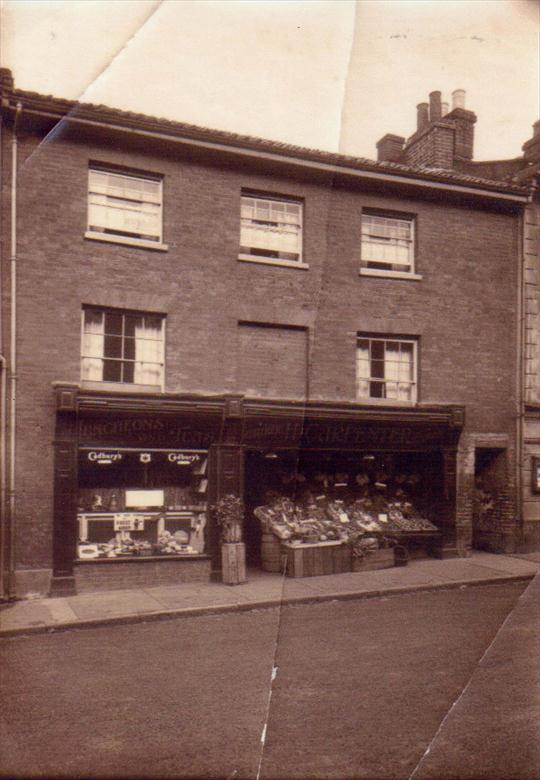 Photograph. H Carpenter, Greengrocer and Cafe Market Place adjacent to Pope's Passage (North Walsham Archive).