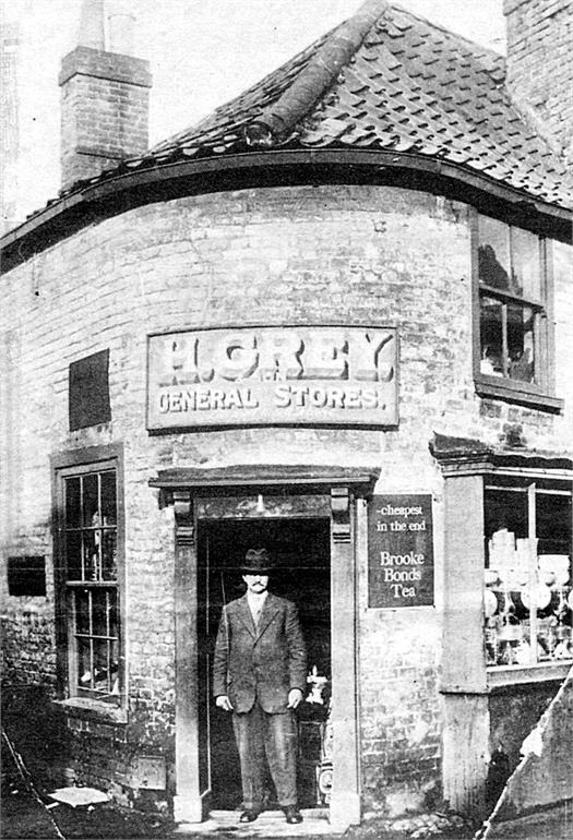 Photograph. H. Grey's general stores on the corner of Bacton Road and Back Street (North Walsham Archive).