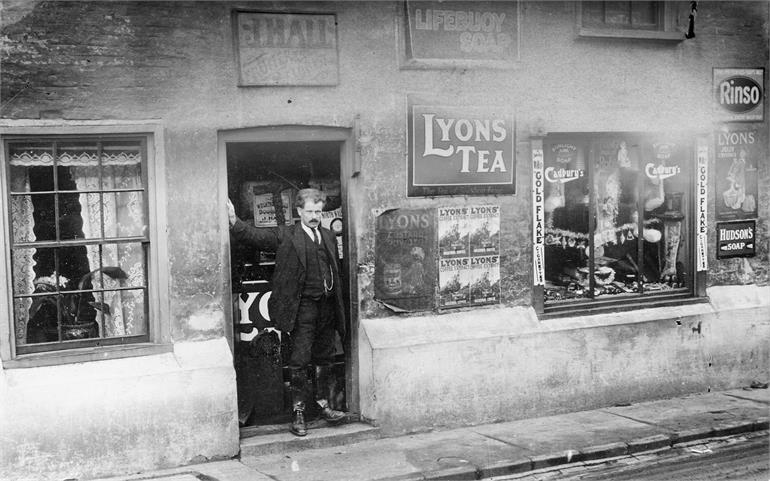 Photograph. Jack Hall at his general stores in Mundesley Road. (North Walsham Archive).