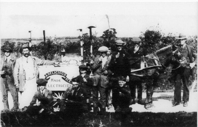 Photograph. John (Joe) White's Ice Cream cart doing a roaring trade near North Walsham. Joe is 2nd left in the picture. (North Walsham Archive).