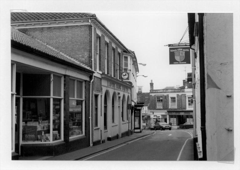 Photograph. Kings Arms Street, North Walsham, looking north towards the Market Place. (North Walsham Archive).