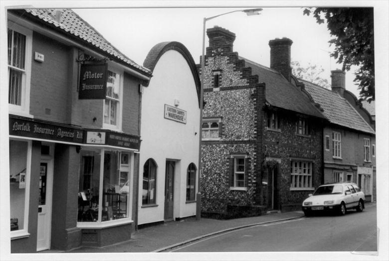 "Photograph. Kings Arms Street, North Walsham; ""Norfolk Motor Insurance"" left; the gable end of the old ""Picturedrome"" centre. Photo R.M.Ling(2) (North Walsham Archive)."