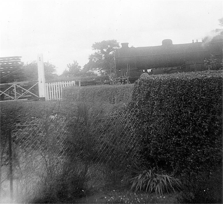 Photograph. Last train through Station Road crossing (North Walsham Archive).