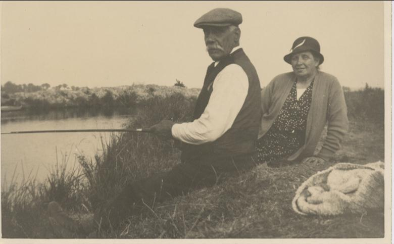 Photograph. Laurence and Selina Maclean fish the Dilham Canal (North Walsham Archive).