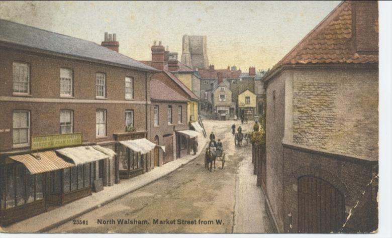 Photograph. Market St., Nth. Walsham. The Norwich Co-operative Society opened in 1906, burned down in 1916, was rebuilt in 1921 and ceased trading in 1963. (North Walsham Archive).