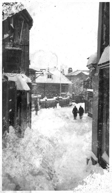 Photograph. Market Street in snow, winter of 1947. (North Walsham Archive).