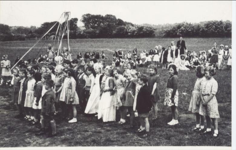 Photograph. May Day celebrations at Manor Road Junior School, 1949. (North Walsham Archive).