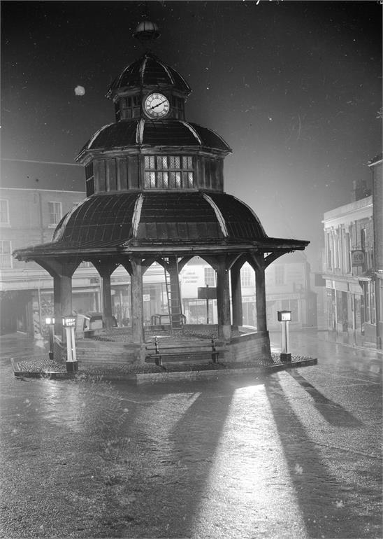 Photograph. North Walsham Market Cross on a rainy night (North Walsham Archive).