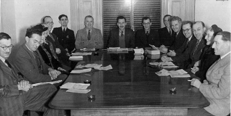 Photograph. The North Walsham.Urban District Council assembled in the Council Chamber. Chairman Ralph E.R.Ling. (North Walsham Archive).