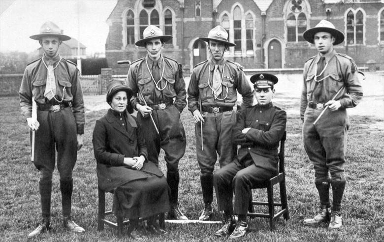 Photograph. North Walsham's Salvation Army Scout Troop on the Peoples Park. Board School, Manor Road in background. (North Walsham Archive).