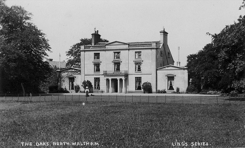 Photograph. The Oaks, North Walsham. Probably Mrs Wilkinson with dog. Demolished in the 1930s (North Walsham Archive).