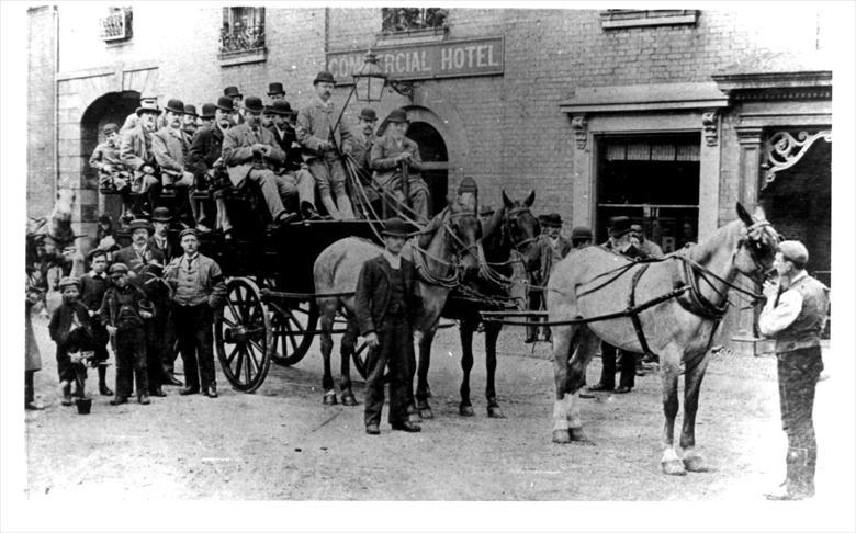 Photograph. A party of people ready to set off on a Horse Bus, pictured outside the Angel Commercial Hotel, Aylsham Road, NorthWalsham. (North Walsham Archive).