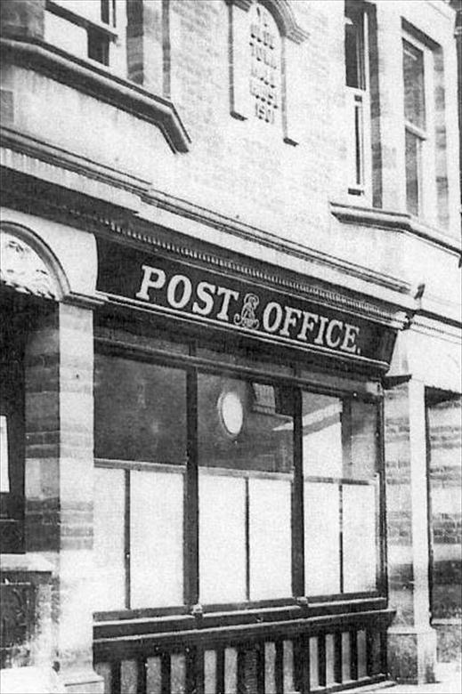 "Photograph. The Post Office occupied the ""Old Town Hall"" in King's Arms Street between 1908 and 1966. (North Walsham Archive)."