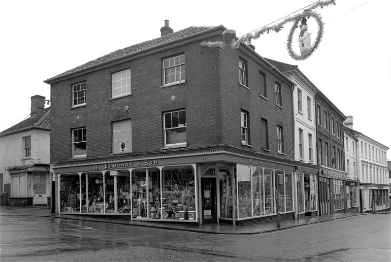 Photograph. R. Edmond & Son, North Walsham Market Place at Christmas time in. (North Walsham Archive).