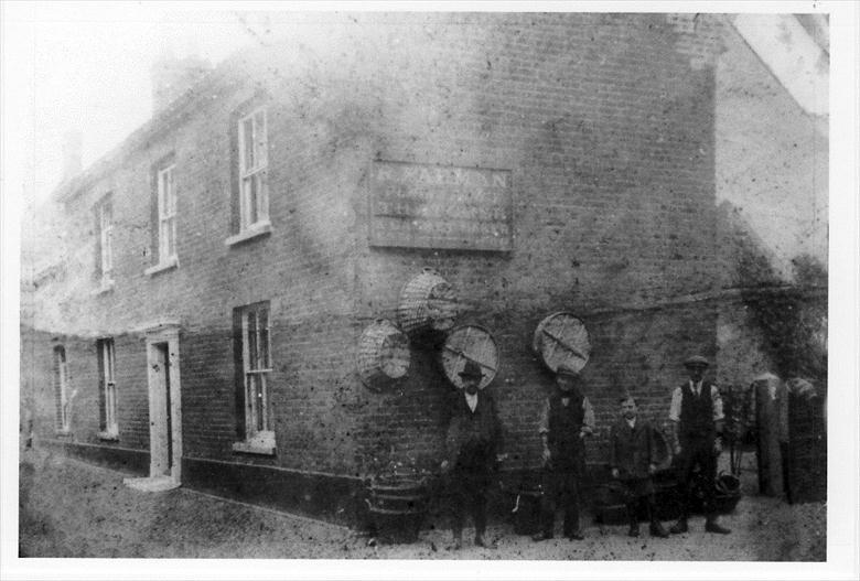 "Photograph. R.Farman, Garden House, Aylsham Road, North Walsham. ""Plain & Fancy Thatcher & Basketmaker"" (North Walsham Archive)."
