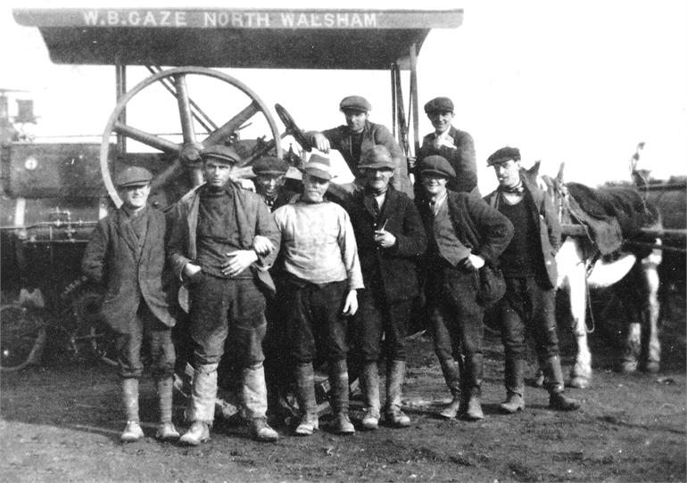"Photograph. Road gang with one of W.B.(""Boyer) Gaze's steam rollers.Gaze had some 6 steam rollers and his works were what is now Antingham Drive, off Bacton Road. (North Walsham Archive)."