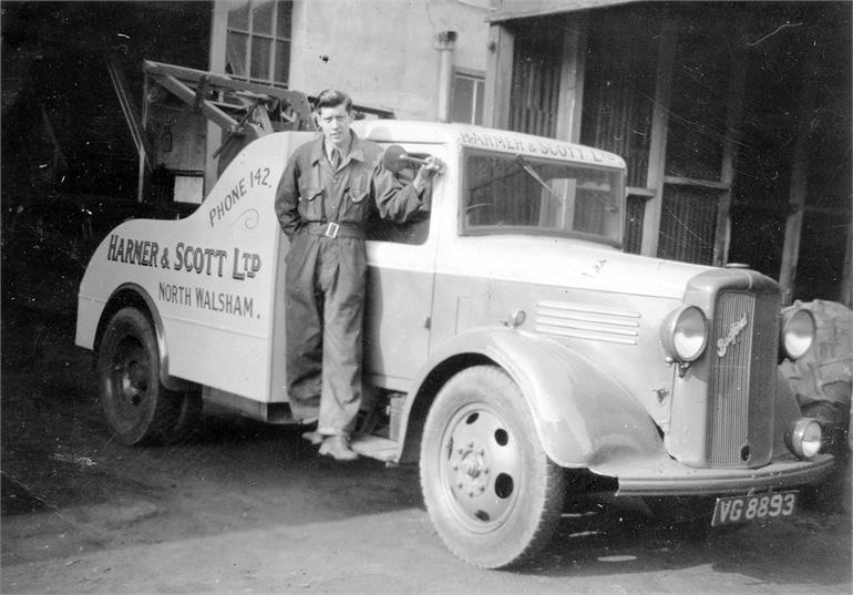 Photograph. Ronnie Drake and the Bedford Breakdown Truck at Harmer & Scott Ltd Garage (North Walsham Archive).