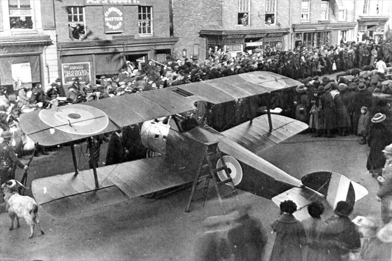 Photograph. Sopwith Camel in North Walsham Market Place. Promotion of War Bonds sales (North Walsham Archive).