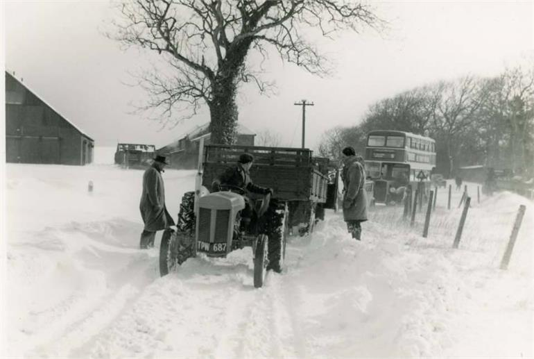 Photograph. Tractor and Eastern Countries bus in snow at Hall Farm, Paston. (North Walsham Archive).