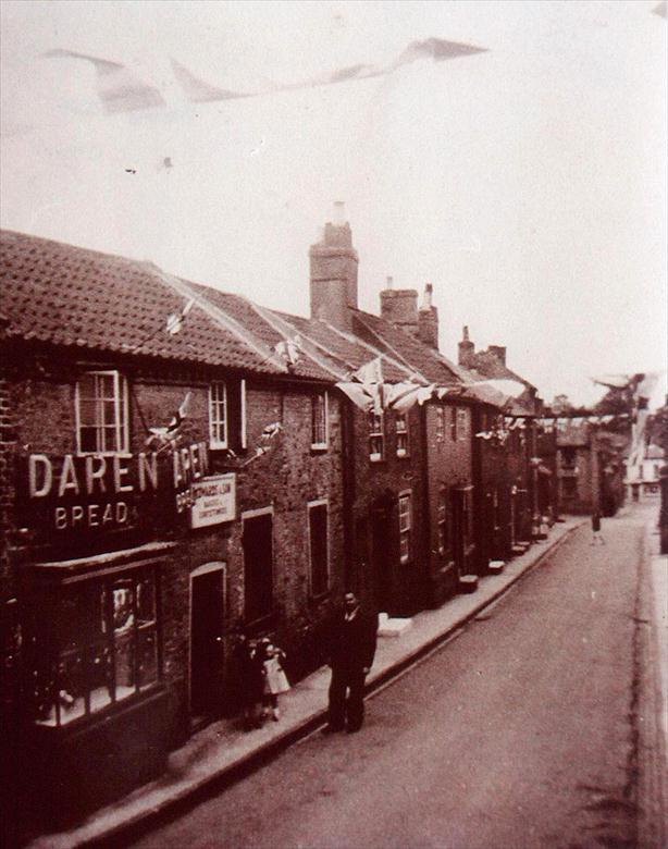 Photograph. Vicarage Street, North Walsham, showing baker's shop (North Walsham Archive).