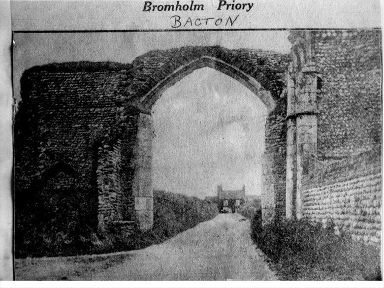Photograph. The view looking northwards through the gateway of Bromholm Priory at Bacton. The priory is now locally known as Bacton Abbey (North Walsham Archive).