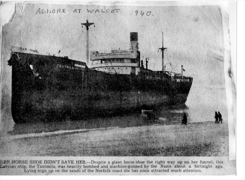 "Photograph. Walcott Beach, 1940. The wreck of the Latvian ship, ""Tautmila"", beached after being heavily bombed and machine gunned by Nazis in World War Two (North Walsham Archive)."