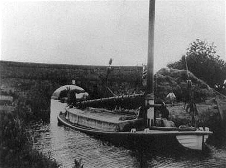 Photograph. Wherry shooting Swafield Bridge on the North Walsham-Dilham Canal. Ling collection (North Walsham Archive).